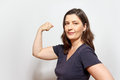 woman flexing biceps muscles assertiveness Royalty Free Stock Photo