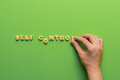 Self controt concept, person making words of cookies isolated on green