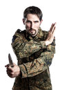 Self defense instructor with knife male camouflage do a exercise isolated on white background Royalty Free Stock Image