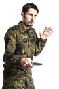 Self defense instructor with knife male camouflage do a exercise isolated on white background Royalty Free Stock Photos