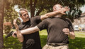 Self defense techniques against a gun kapap instructor demonstrates Stock Photography