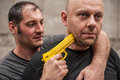 Self defense techniques against a gun kapap instructor demonstrates Stock Images
