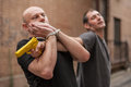 Self defense techniques against a gun kapap instructor demonstrates Stock Photo