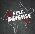 Self defense words chalk outline body defending yourself attack on a of a dead or victim to illustrate the need to defend from a Royalty Free Stock Image
