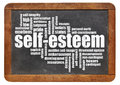 Self esteem word cloud on isolated vintage blackboard Stock Photos