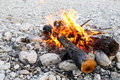 Self-made campfire on shore of mountain river