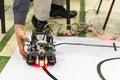 Self-made robot from Lego blocks. Human hand.