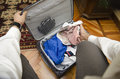 Self point of view of man packing suitcase with clothes Stock Images