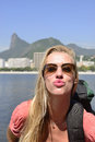 Self-portrait of blond young backpacker at Rio de Janeiro. Royalty Free Stock Images