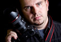Self portrait of the photographer with DSLR camera Royalty Free Stock Images