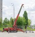 Self propelled crawler crane with telescoping boom on asphalt si