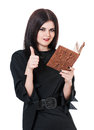 Self satisfied witch with book of spells and okay gesture isolated on white background Stock Photography