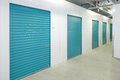 Self storage units a perspective view of a row of with closed blue doors Royalty Free Stock Image