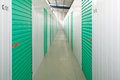 Self storage units a perspective view of a row of with closed green doors Royalty Free Stock Images