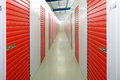 Self storage units a perspective view of a row of with closed red doors Royalty Free Stock Image