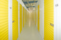 Self storage units a perspective view of a row of with closed yellow doors Royalty Free Stock Photography