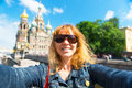 Selfie on the background of church of the savior on blood a young female tourist spilled cathedral resurrection Royalty Free Stock Photos