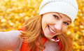Selfie beautiful woman photographing themselves outdoors in aut autumn Royalty Free Stock Photos