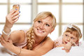 Selfie from bedtime daughter and mother are happy together making with smartphone freetime in bed Royalty Free Stock Images