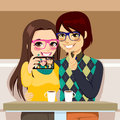 Selfie couple photo young taking together with mobile phone camera at a coffee shop Royalty Free Stock Images