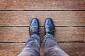 Selfie of foot and legs with black derby shoes seen from above Royalty Free Stock Photo