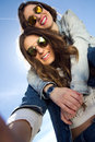 Selfie girls taking photos with a smartphone two sunglasses Royalty Free Stock Images