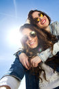 Selfie girls taking photos with a smartphone two sunglasses Stock Photos