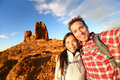 Selfie happy couple taking self portrait hiking photo two lovers or friends on hike smiling at camera outdoors mountains by roque Royalty Free Stock Images