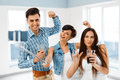 Selfie Photo. Friends Taking Picture With Smartphone Selfie Stic Royalty Free Stock Photo