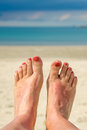 Selfie of woman bare feet, beach and sea Royalty Free Stock Photo