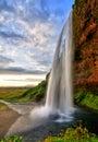 Seljalandfoss waterfall at sunset in HDR, Iceland Royalty Free Stock Photo