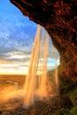 Seljalandfoss waterfall at sunset, Iceland Royalty Free Stock Photo