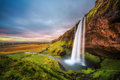 Seljalandsfoss Waterfall  in Iceland at sunset Royalty Free Stock Photo