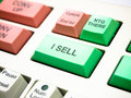 Sell button key on investment keyboard Royalty Free Stock Photos
