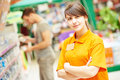 Seller assistant in shop Royalty Free Stock Photo