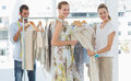 Seller helping shopper choose clothes in store female the the Royalty Free Stock Photo