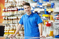 Seller at home improvement store Royalty Free Stock Photo