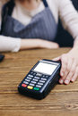 Seller and POS machine Royalty Free Stock Photo