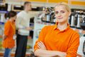 Selles assistant positive seller or shop portrait in supermarket store Stock Image