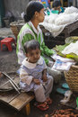 Sellig desiccated coconut woman with child sells on the traditional asian bazaar in nyaungshwe village myanmar burma Royalty Free Stock Photography