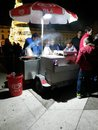Selling chestnuts chestnut seller at night in downtown lisbon Royalty Free Stock Photos