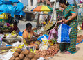 Selling coconuts and oil lamp plates in the streets of bangalore bengaluru india circa november young woman sells flowers along Royalty Free Stock Photo