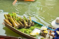 Selling food on a boat at floating market, Thailand Stock Photos