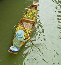 Selling food on a boat at floating market, Thailand Royalty Free Stock Image