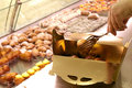 Selling pastries especially the filling of a tray Royalty Free Stock Images