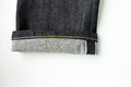 Selvedge denim jeans closeups photo from close range Stock Photo
