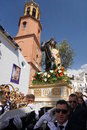 Semana santa in andalusia a procession the holy week or easter week the andalusian village of competa some young men looking like Stock Photo