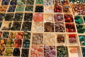 Semi precious gemstones of different colors and shape for sale Royalty Free Stock Images