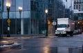 Semi truck with box trailer in night rainy city street Royalty Free Stock Photo