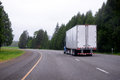 Semi truck with dry van semi truck moving on scenic curvy highway Royalty Free Stock Photo